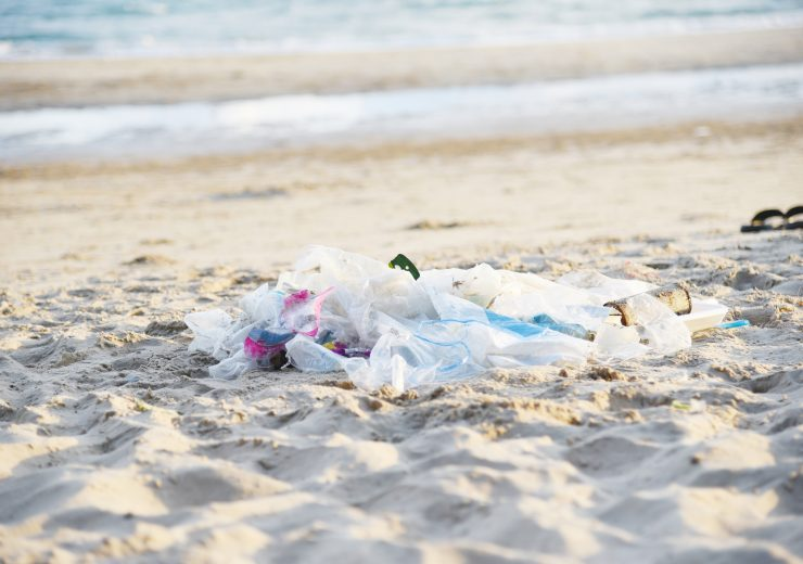 Garbage in the sea with bag plastic bottle and other garbage bea